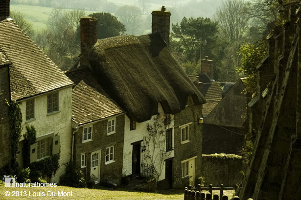 A Thatched Stone Cottage On Gold Hill In Shaftesbury England