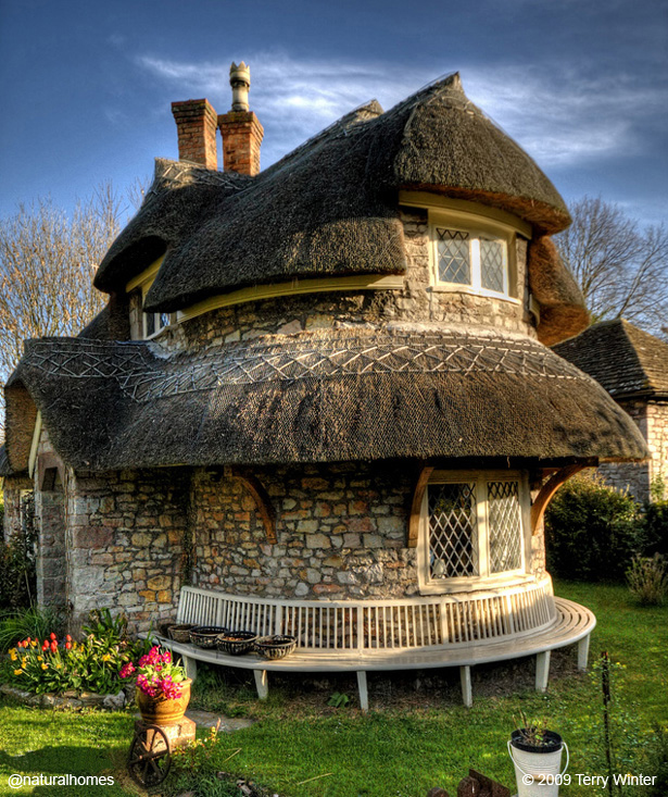 The thatched circular cottage at blaise hamlet england - The thatched cottage ...