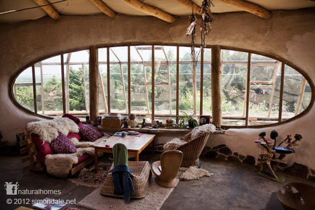 Beautiful living rooms in natural homes around the world for Beautiful natural houses